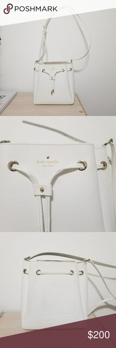 "Kate Spade Bucket Bag Super cute white Kate Spade bucket bag that goes with almost any outfit It was minimally used and still looks and feels completely new!  Description from the website: SIZE  10.5"" h x 9.6"" w x 3.7"" d  drop length: 22""  MATERIAL  double face crosshatched leather with matching trim14 karat gold plated hardwareunlinedstyle # pxru6407  DETAILS  crossbody bucket bag with drawstring closureinterior slide pocketkate spade new york gold embossed signature with stud kate spade…"