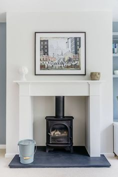 Chesney's contemporary gas stove, slate hearth, Lowry print. Log Burner Living Room, Living Room With Fireplace, New Living Room, Living Room Interior, Living Room Decor, Kitchen Interior, Dining Room, Fireplace Surrounds, Fireplace Design