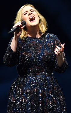 Adele from The Big Picture: Today's Hot Pics  Hello! The singer performs to a delighted crowd in Manchester, England.
