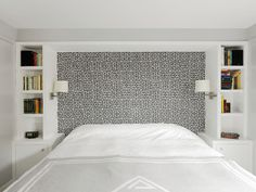 Graphic wall covering with flanking bookcases instead of a headboard.  Bedroom - Modern - Bedroom - boston - by Hart Associates Architects, Inc.