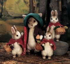 So adorable! Needle felted bunny family. I really like how they're wearing clothes like people. They're just too cute!