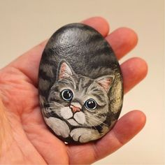 I'm working on adding new stones to my #etsyshop in time for Christmas shopping. This would make a perfect stocking stuffer for any cat lover!  Find me at Pet Rocks by Theresa on both Etsy and Facebook.  #christmas #christmasshopping #merrychristmas #catlovers #cats #catpainting #paintedrocks #painting #paintedstones #rockpainting #rockart #rock #cat #cateyes #catart #petrock #kitty #kitten