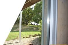 Pushing aside a #curtain from a bedroom in VALDONICA you can admire the beautiful #garden shaded by #ancient trees.