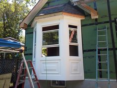 constructing bay windows | Walk-out Bay Windows gets all trimmed out with picture frame ...