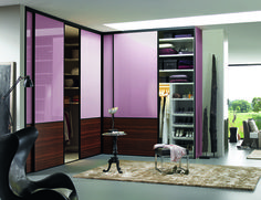 Big, modern, conceptual L shape wardrobe with plenty of cupboard space and purple finishings. Eckschrank Flieder: Wardrobes & closets by CABINET Schranksysteme AG