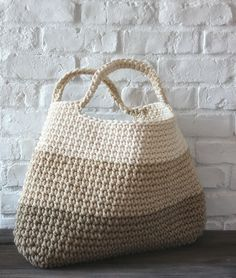 """""""crochet basket/bag..no pattern found just a great photo and inspiration..."""" It is I love the colours including the painted brick wall S"""