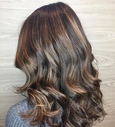 We are loving this gorgeous brunette created by the talented Erika! So dimensional, and oh so rich! 👏🏻👏🏻 . . . #balayage #brunettebalayage #brunettehair #bostonhair #bostoncolorist #bestofbostonsalon #longhair #curlyhair #hairgoals @matrixusa @behindthechair_com @erikashears | Content shared via Matrix Inspiration Gallery