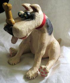 whimsical paper mache dog with bone