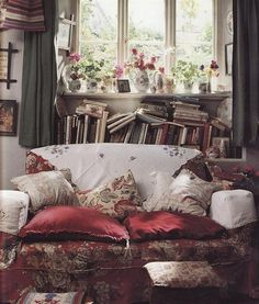 never enough books..stuffed in everywhere Love the messy lived in look
