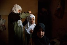Girls in Sadah get ready for school.