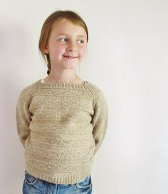 This sweater is worked in the round from the top down. Short rows are used on the larger sizes to shape the neckline. A textured pattern is worked across the body of the sweater and the sleeves are knit in stockinette stitch, both are finished with ribbing. Stockinette, Girls Sweaters, The Row, Larger, It Is Finished, Neckline, Shape, Pullover, Stitch