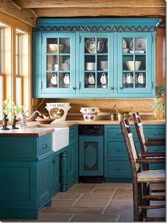 Turquoise cabinets and butcher block top.  An interpretation.