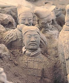 terra cotta statues china | Half-buried terra-cotta soldiers are among the army of about 8,000 ...
