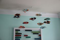 Pinwheel mobile. LOVE. Abacus on the wall. ALSO LOVE.