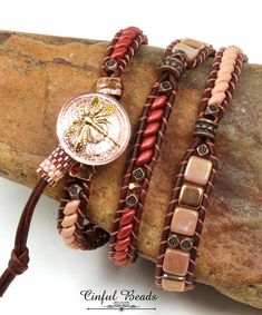 A stylish Bohemian leather wrap bracelet. This bracelet features Czech glass beads in peach tones. It utilizes superduos, two hole tiles, druks, and Hawaiian flower beads. They have all been stitched onto 1.5mm natural red brown leather and have been interspersed with Tibetan