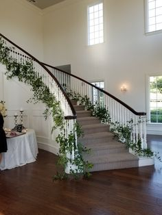 We enjoyed adding the greenery decor to this fabulous staircase! Venue: The Milestone, Aubrey, Tx Florals: Haute Poppies, McKinney, Tx Wedding Staircase Decoration, Wedding Stairs, Staircase Railings, Stairways, Banisters, Hanging Centerpiece, Stairway Decorating, Greenery Decor, Flower Installation