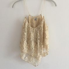 Ecote Metallic Gold Tann Gold & cream sheer shimmery metallic gold tank top by Ecote from Urban Outfitters in size Extra Small. Only worn once, in perfect condition. The body layer is 60% Nylon, 40% Metallic & the chiffon is 100% Polyester. Hand wash cold. Ecote Tops Tank Tops