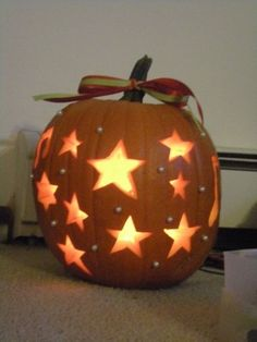 Pumpkin I carved. Some designs are just to hard. This is super cute and simple. I added plastic pearls put on with a hot glue gun.