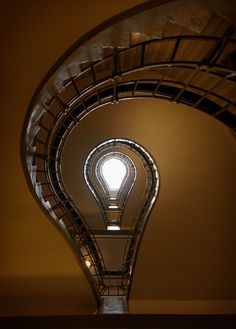 Staircase at the Cafe Orient, Prague.  This is my version of the staircase.  Example of Angle and Framing. Camera is positioned on back on floor, manual focus/exposure.  Photographer: Anne Shields