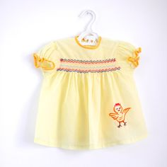 OMG, I had a dress that was so similar to this.  Mine had a lamb.