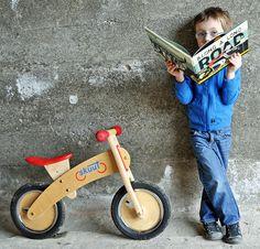 """skuut balancing bike and book """"along a long road"""""""