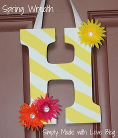 DIY Summer Wreath-Buy a white letter from Michaels, paint diagonal stripes, hot-glue flowers with rhinestone middles onto corners. Hot-glue a white wide ribbon to hang.