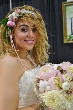Very romantic and sweet headpiece with lace and pearl strings as well as blush pink ranuncula. www.ParkFlorist.us
