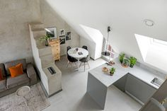This apartment located under the roof has only a mezzanine bedroom, but benefits of a terrace  with floor in cement tiles