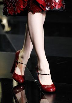 Louis Vuitton - love those red shoes!