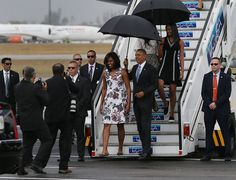 President Barack Obama, Michelle Obama and Sasha Obama (R) walk down the stairs as they arrive at Jose Marti International Airport on Airforce One for a 48-hour visit on March 20, 2016 in Havana, Cuba.