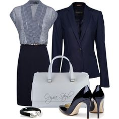 Classic navy suit with navy and white blouse.