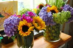 Fill a vase with peppers or limes, add colorful flowers for centerpieces for a Cinco de Mayo party!