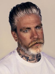 Tattoos, gray hair, and a beard! Be still, our hearts. Meet Miles Better, the tattooed model and tattoo artist that has the internet all abuzz. His name truly says it all, he clearly is Miles Better than all the rest.