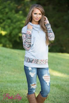We love the cute cowl neck trend - and we have the perfect sweater for you to rock this look, too! This sweater features heather grey material paired with a beautiful aztec print on the sleeves and at the bottom hemline for a stellar look!