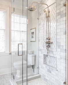 Love the shower tiles and the glass enclosure