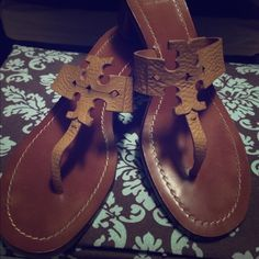 Tory Burch Sandals Authentic Tory Burch sandals, size 9M, excellent condition. Royal Tan pebbled leather logo at top, top stitched leather sole, wooden stacked heel, slip on style. ZERO visible signs of wear!! Only signs of wear are on the bottom of the sole. Worn a handful of times! Easy summer style! Tory Burch Shoes Sandals