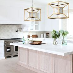 statement pendants over island
