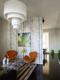 "We love seeing all the ways in which people use ""Woods"" wallpaper. The versatile black and white on show here."