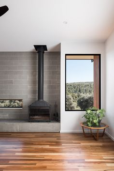 Concrete block and timber floors to create a warm industrial feel. The well positioned window is framing the view like a piece of art to. www.get-frank.net is a matchmaker who finds the right designer or architect for you.