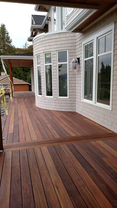 """Mahogany decking applied with Penofin Exotic Hardwood Exterior Stain """"IPE"""" Color. Applied with CAMO Marksman Hidden Deck Fasteners"""