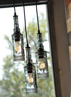 The Parisian, old fashioned recycled bottle chandelier, made with antique glass bottles.