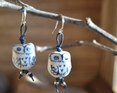 Playful owl dangle earrings.