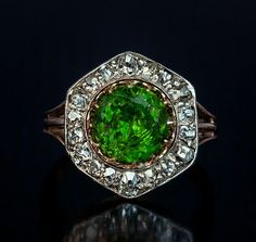 A Rare Almost 3 Carat Russian Demantoid and Diamond Ring made between 1908 and 1917 The silver topped 14K gold ring features a very large vivid grass green