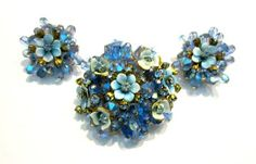 Alice Caviness Brooch Set Designer Signed Vintage Jewelry Blue Enamel Rhinestone Flower Set Brooch Earrings   Amazing designer Alice Caviness signed set. Gorgeous enameled blue flowers and rhinestones with pinned crystals, to die for! Brooch and earring set, only the earrings show any normal wear on the backside only. Both are bright, vibrant and glowing! The set is in excellent used vintage condition. Please review all 5 pictures.  Brooch - 2 round Earrings - 1 1/4 round  U.S. Shipping ...