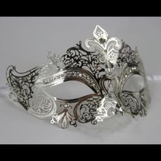 "Silver Masquerade Mask Laser Cut with Rhinestones Made with high quality eco-friendly metal. Mask measures approximately 7""W x 4*H. Perfect for all masquerade events, weddings, proms, Mardi Gras, photo shoots, etc. Accessories"