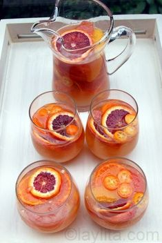 Moscato sangria with citrus fruits. - have no idea what this would taste like but I just LOVE the color combo of the fruits!