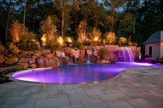 This inground pool features fiber optic lights, LED pool lights, four waterfalls, a swim-in grotto, glass tile finishes, and a lush landscape. Description from prweb.com. I searched for this on bing.com/images