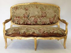 A Very Fine French Louis XV Style 19th Century Three Piece Gildwood Carved and Silk Aubusson Tapestry Five Piece Salon Suite, Comprising of a Settee and Two Fauteuils, the Aubusson silk tapestry in perfect condition, the finely carved frame with the original 24 carat gildwood. Circa: 1880