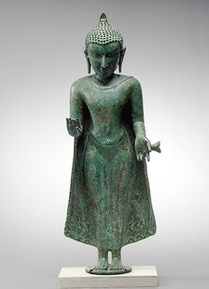 Standing Buddha, Pagan period, 12th–13th century Burma Bronze with silver inlay; H. 19 7/8 in. (50.5 cm)
