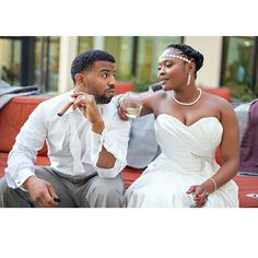 I love this shot by @ubaraphoto Hair braided and pinned up, gorgeous #weddingdress and a glass of whiskey. #groom is dapper. #winning! #NaturalHairBride